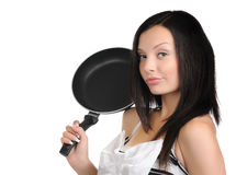 Young beautiful girl with a frying pan Stock Photos