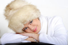 The young beautiful girl in fur. On a white background Royalty Free Stock Image