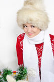 The young beautiful girl in a fur cap. And a red sweater Royalty Free Stock Images