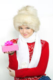The young beautiful girl in a fur cap. On a white background with a New Year Stock Image