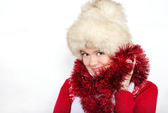 The young beautiful girl in a fur cap. On a white background with New Year Royalty Free Stock Images