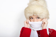 The young beautiful girl in a fur cap. And a red sweater Stock Photography