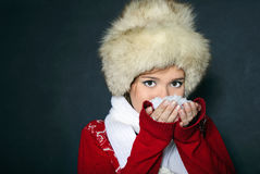 The young beautiful girl in a fur cap. Has control over snow Stock Photo