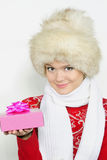 The young beautiful girl in a fur cap Royalty Free Stock Image