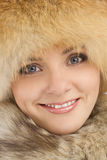 Young beautiful girl in fur hat. Close up portrait of young beautiful girl in fur hat over white background stock photography