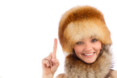Young beautiful girl in fur hat. Close up portrait of young beautiful girl in fur hat over white background royalty free stock images