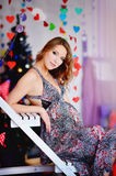A young, beautiful girl, a future mother dressed up a tree and p stock image