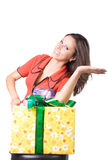 The young beautiful girl with a gift box Royalty Free Stock Images