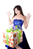 The young beautiful girl with a gift box. On a white background Royalty Free Stock Photography