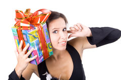 The young beautiful girl with a gift box. On a white background Royalty Free Stock Photo