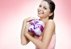 Young beautiful girl with a gift box Stock Photography