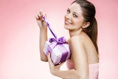 Young beautiful girl with a gift box ribbon Royalty Free Stock Image