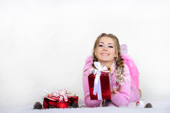 The young beautiful girl with gifts. On a white background Stock Photos