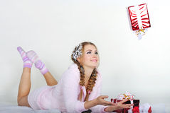 The young beautiful girl with gifts. On a white background Royalty Free Stock Image