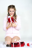 The young beautiful girl with gifts. On a white background Royalty Free Stock Images