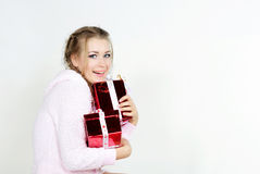 The young beautiful girl with gifts. On a white background Stock Photography