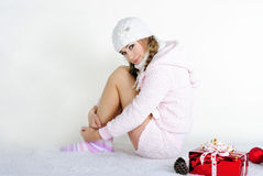 The young beautiful girl with gifts. On a white background Stock Image