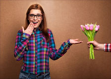 Young beautiful girl gives a bouquet of tulips man Royalty Free Stock Photography