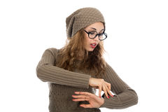 Young beautiful girl with glasses looking at his watch. Stock Image