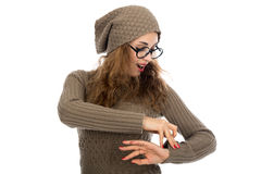 Young beautiful girl with glasses looking at his watch Royalty Free Stock Photos