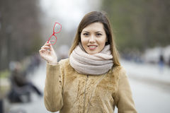 Young beautiful girl with glasses in the park. Posing and smiling Stock Photo
