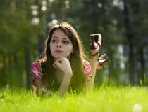 Young beautiful girl on a grass Stock Photography