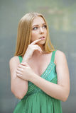 Young beautiful girl in the green dress talking on cell phone Stock Photography