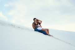 Young beautiful girl and guy  in love outdoors Stock Photos