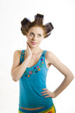 Young beautiful girl in hair curlers Royalty Free Stock Photo
