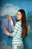 Young beautiful girl hangs clothes Stock Photo