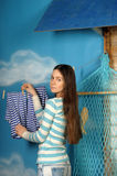 Young beautiful girl hangs clothes Royalty Free Stock Photo