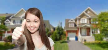 Young beautiful girl is happy. Habitation ans cottage Stock Photography