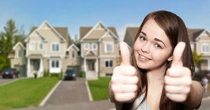 Young beautiful girl is happy. Habitation ans cottage Royalty Free Stock Photos