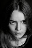 Young beautiful girl. Hard serious look at the camera. Royalty Free Stock Photo