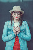 Young beautiful girl in hat with cup of coffee Royalty Free Stock Photo