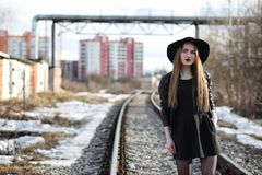 Young beautiful girl in a hat and with a dark make-up outside. G. Young beautiful girl in a hat and with a dark make-up oute. Girl in the Gothic style on the Stock Images