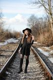 Young beautiful girl in a hat and with a dark make-up outside. G. Irl in the Gothic style on the street. A girl walks down the city street in a leather waistcoat Stock Images