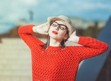 Young beautiful girl in hat and glasses enjoy sunlight Stock Photo