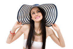 Young beautiful girl in a hat Stock Image