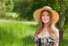 Young beautiful girl with hat posing outdoor Stock Image