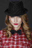 Young beautiful girl in a hat and red shirt Royalty Free Stock Photos