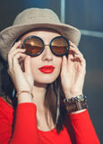 Young beautiful girl in hat and sunglasses enjoy sunlight Royalty Free Stock Photos