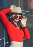 Young beautiful girl in hat and sunglasses enjoy sunlight Stock Photo