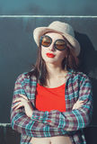 Young beautiful girl in hat and sunglasses enjoy sunlight Stock Photography