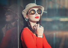 Young beautiful girl in hat and sunglasses enjoy sunlight Stock Image