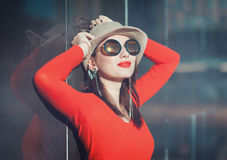 Young beautiful girl in hat and sunglasses enjoy sunlight Royalty Free Stock Images