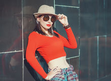 Young beautiful girl in hat and sunglasses enjoy sunlight Stock Photos