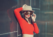 Young beautiful girl in hat and sunglasses Stock Photography