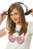 The young beautiful girl with headphones Royalty Free Stock Images