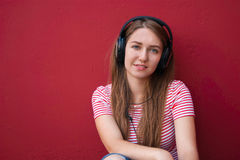 Young beautiful girl in headphones listening to music Stock Image